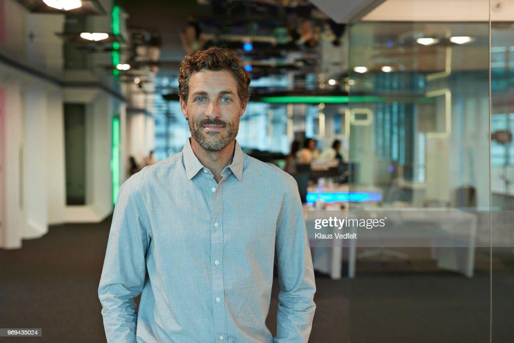 Portrait of businessman inside high-tech office : Foto stock