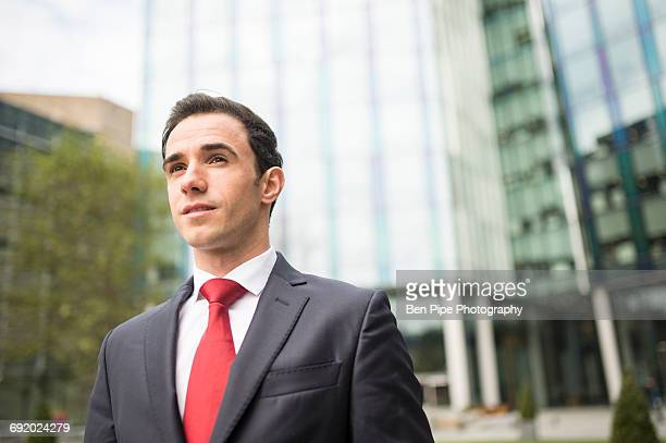 portrait of businessman looking away - red suit stock pictures, royalty-free photos & images