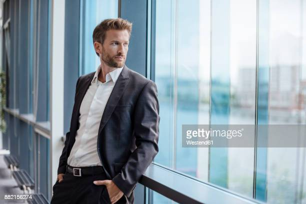 Portrait of businessman looking out of the window