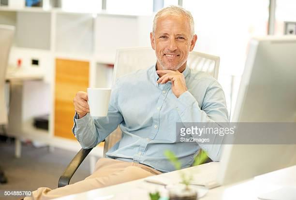 Portrait of businessman near his desk