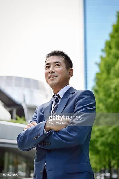 Portrait of businessman outside office building