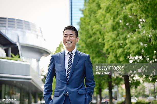 Portrait of businessman outside office building