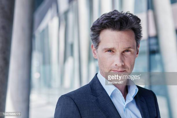 portrait of businessman - metallic look stock-fotos und bilder