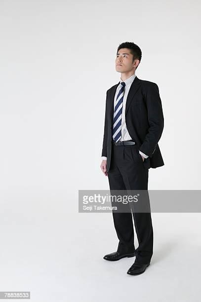 portrait of businessman - 見上げる ストックフォトと画像
