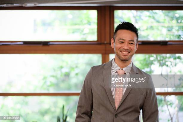 portrait of businessman - japanese ethnicity stock pictures, royalty-free photos & images