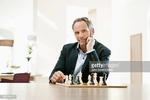 Portrait of businessman playing chess