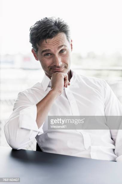 Portrait of businessman raising eyebrows