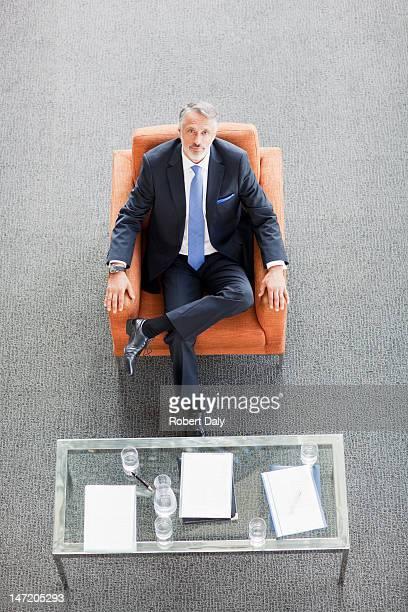 Portrait of businessman sitting in armchair