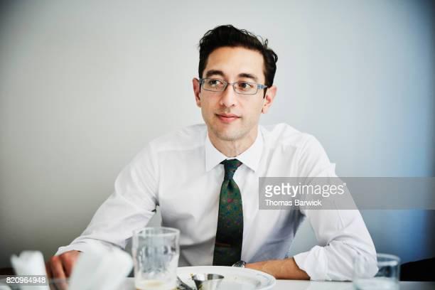 Portrait of businessman sitting in cafe