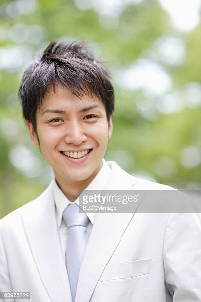 Portrait of businessman smiling, close up