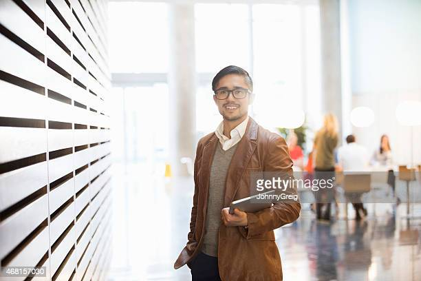 portrait of businessman smiling in office - incidental people stock pictures, royalty-free photos & images