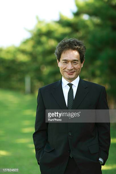 Portrait of businessman smiling outdoors