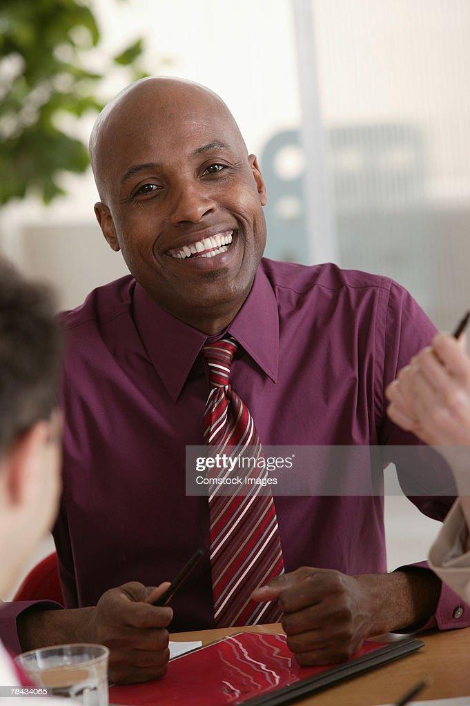 Portrait of businessman smiling : Foto de stock