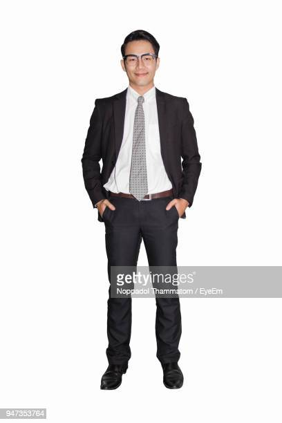 Portrait Of Businessman Smiling While Standing Over White Background