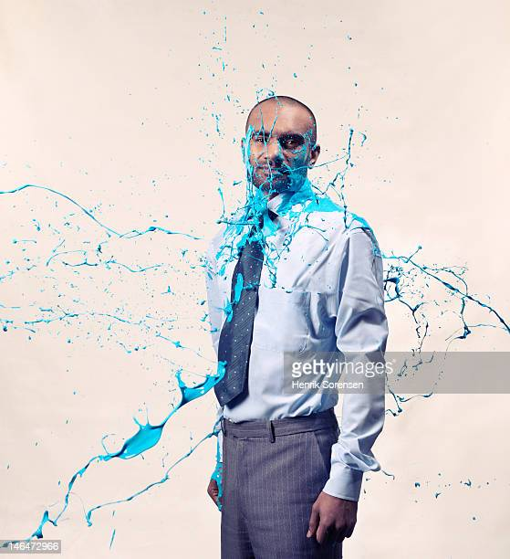 Portrait of Businessman sprayed with paint