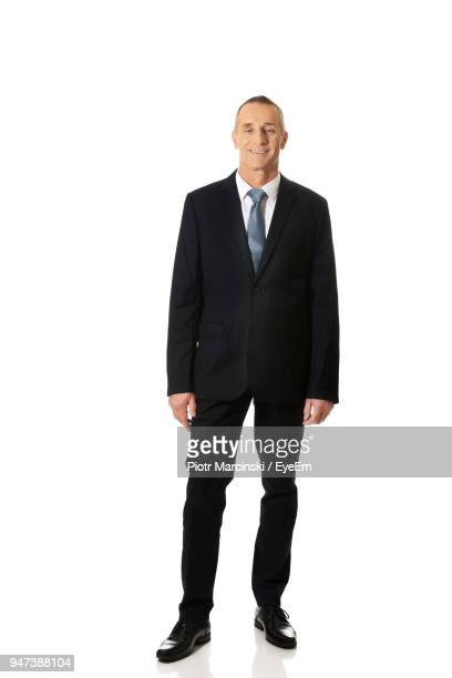 Portrait Of Businessman Standing Against White Background