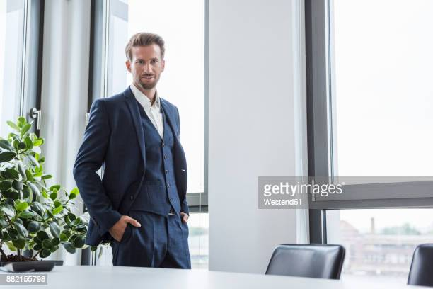 portrait of businessman standing in his office - waistcoat stock photos and pictures