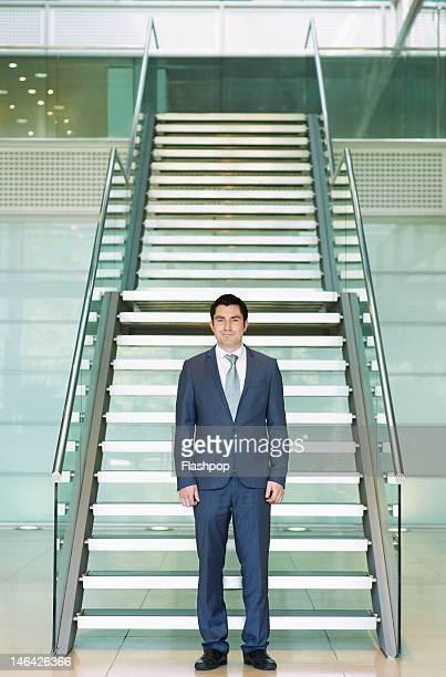 Portrait of businessman standing in modern office