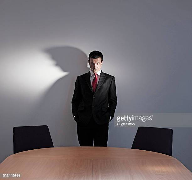 portrait of businessman standing in office - hugh sitton bildbanksfoton och bilder