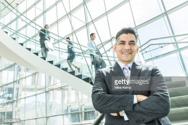 Portrait of businessman standing near staircase