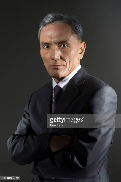 Portrait of businessman standing with arms folded