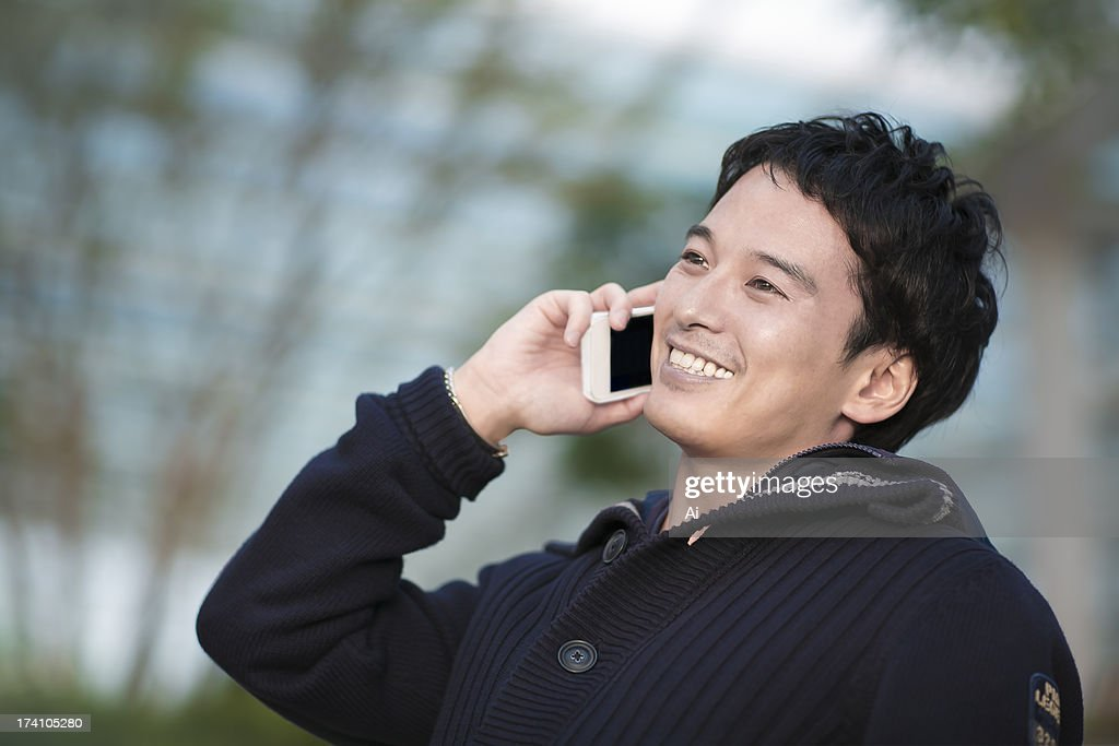 Portrait of businessman talking cell phone : Stock Photo