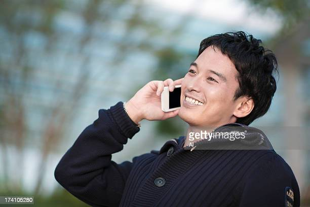 portrait of businessman talking cell phone - 30代 ストックフォトと画像