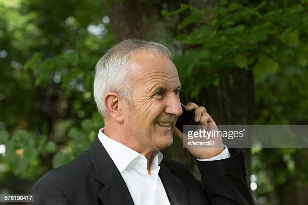 Portrait of businessman telephoning with smartphone