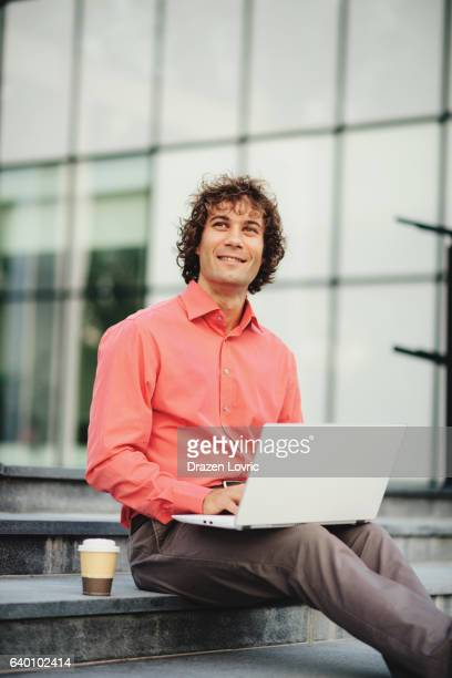 portrait of businessman using laptop on public wi-fi spot - drazen stock pictures, royalty-free photos & images