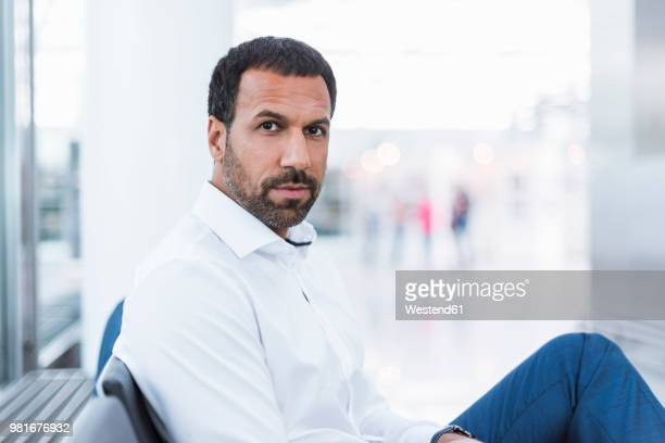 Portrait of businessman waiting in waiting hall