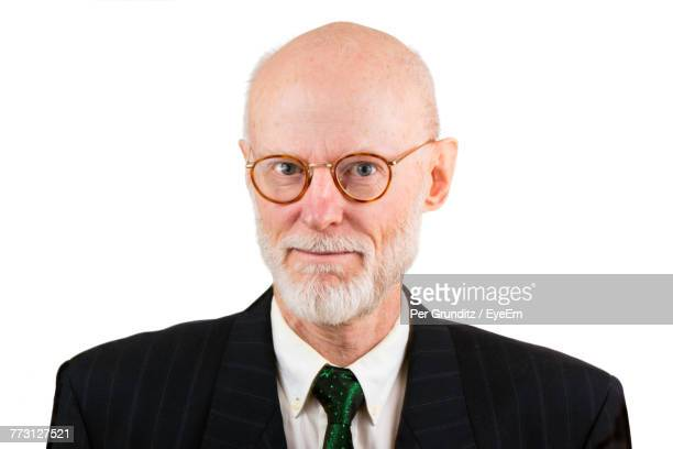 Portrait Of Businessman Wearing Eyeglasses Against White Background