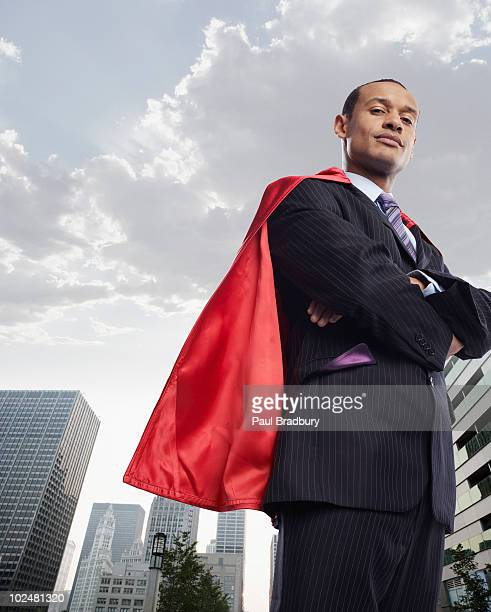 Portrait of businessman wearing red cape