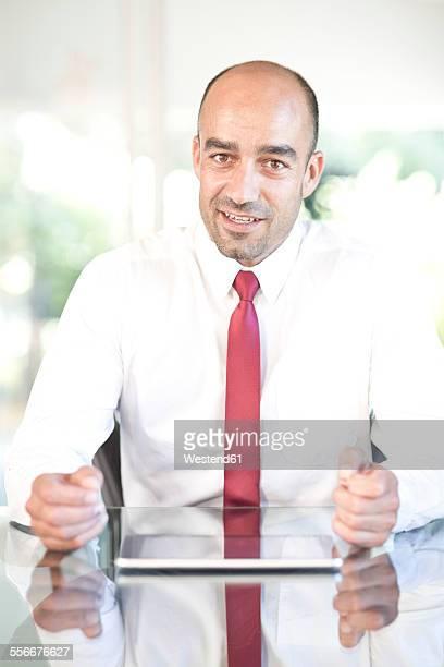 Portrait of businessman wearing red tie