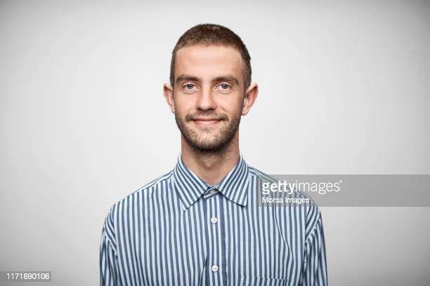 portrait of businessman wearing striped shirt - striped shirt stock pictures, royalty-free photos & images