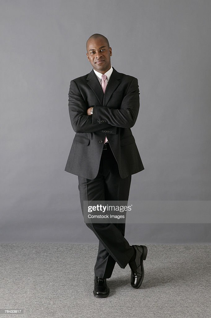 Portrait of businessman with arms crossed : Stockfoto