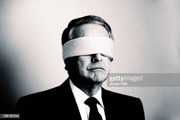 portrait of businessman with blindfold on, black and white - blindfold stock pictures, royalty-free photos & images