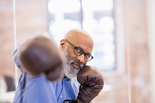 Portrait of businessman with boxing gloves - gettyimageskorea