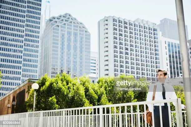 Portrait of businessman with cityscape in background