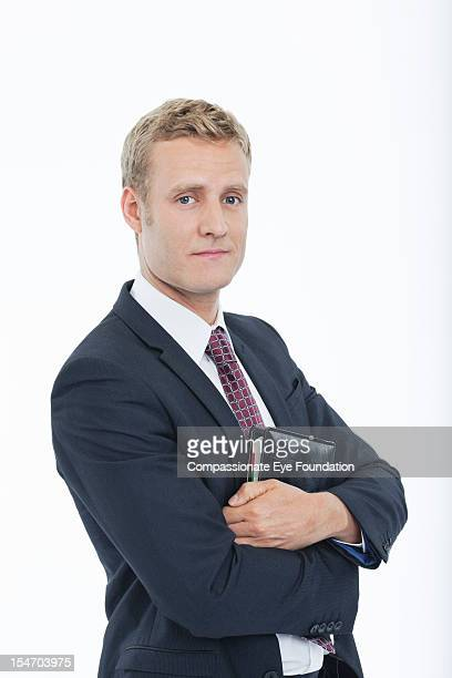 Portrait of businessman with diary