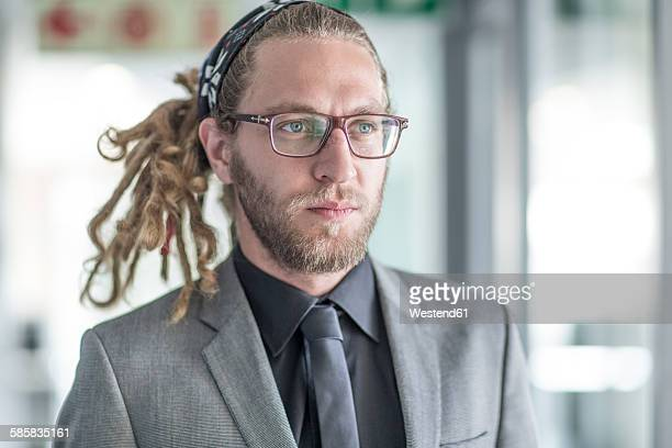 Portrait of businessman with dreadlocks wearing suit
