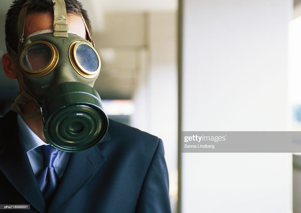 Portrait of businessman with gas mask covering  face : Stockfoto