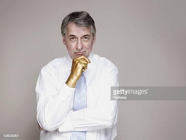 Portrait of businessman with golden hand