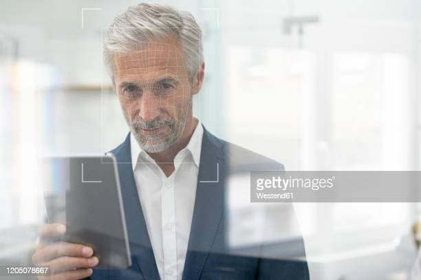 portrait of businessman with grid over his face - identity stock pictures, royalty-free photos & images