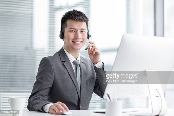 Portrait of businessman with headset