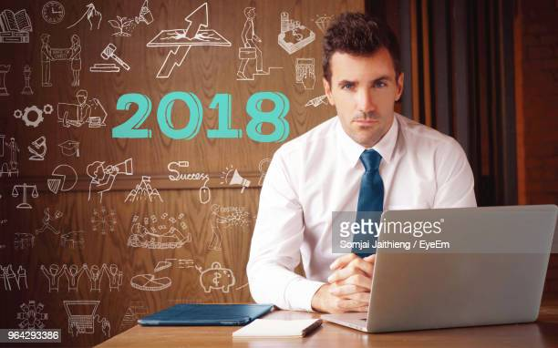 portrait of businessman with icons at office - school icon stock photos and pictures