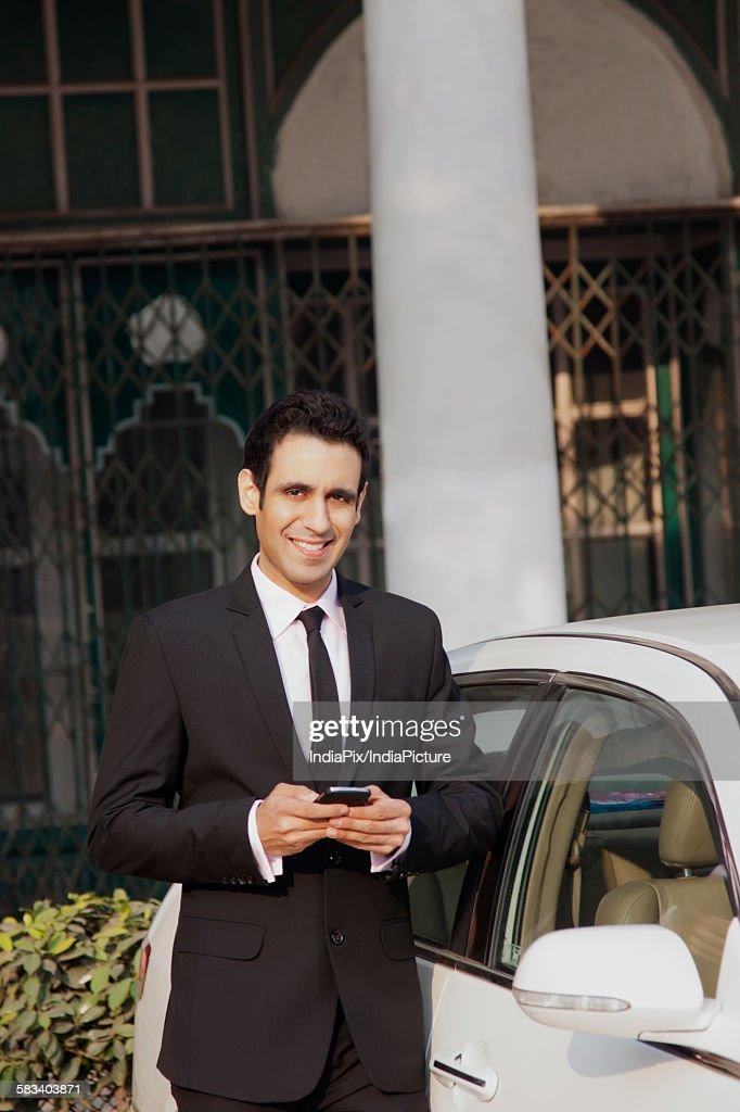 Portrait of businessman with mobile phone , INDIA , DELHI : Stock Photo