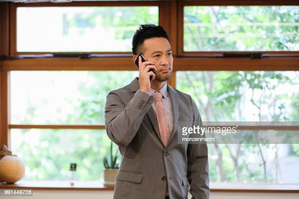 Portrait of businessman with smart phone in hand