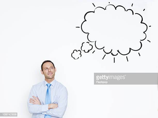 portrait of businessman with thought bubble - thought bubble stock pictures, royalty-free photos & images