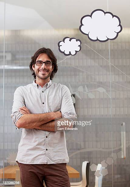 portrait of businessman with thought bubbles overhead - thought bubble stock pictures, royalty-free photos & images