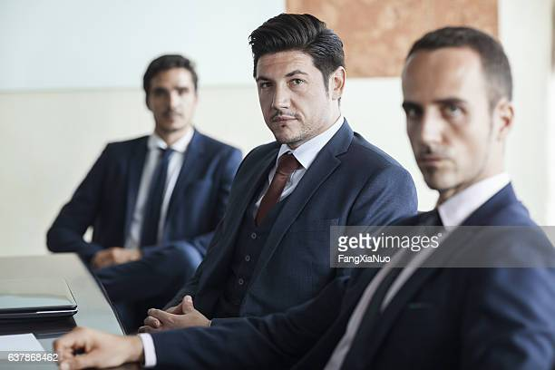 portrait of businessmen in office conference room - blank expression stock pictures, royalty-free photos & images